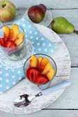 fresh tasty fruit salad on blue wooden table
