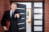 pic of house representatives  - House agent standing in front of door - JPG