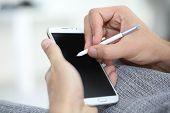 Closeup of digital pen on smartphone screen