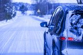 image of dangerous  - Car covered with snow on a dangerous road with snow and ice - JPG