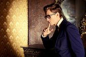 picture of respect  - Handsome respectable man in elegant suit stands in a room with classic vintage style - JPG