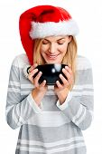 young woman in Christmas hat smiling full of joy and festive happiness