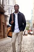 portrait of serious trendy modern hipster black african businessman in urban city