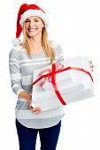 Christmass gift sale and merry young lady with santa hat and smile