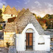 pretty trulli houses in  Alberobello, Puglia, Italy