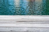 Close Up of Edge of Wooden Decking Surrounding Swimming Pool