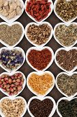 Herbal tea selection in heart shaped porcelain bowls.