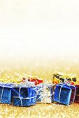 Decorative holiday colorful gift boxes on bright shiny background