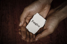 pic of forgiveness  - Forgive stone block in hands with dark background - JPG