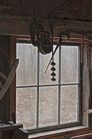 foto of blacksmith shop  - Antique Tools Hanging by the Window of an Old Blacksmith Shop  - JPG