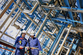 stock photo of pipeline  - refinery workers and pipelines in full HDR colors - JPG