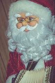 picture of accordion  - Christmas santa toy playing the accordion vintage photo effect background - JPG