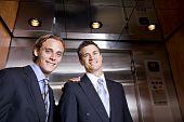 Businessmen Riding In Elevator