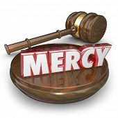 image of forgiven  - Mercy 3d word in red letters on a gavel to illustrate lenient sentencing in a verdict or judgment in a court legal trial case - JPG