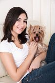 foto of hairy tongue  - Portrait of young beautiful woman holding her dog - JPG
