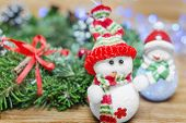 pic of snowmen  - toy snowman Christmas wreath on a wooden background bokeh - JPG