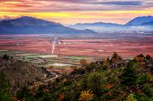 stock photo of fertilizer  - Beautiful sunset over the fertile plains in southern Croatia - JPG