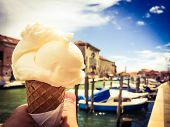 stock photo of cone  - Eating a lemon gelato cone on Murano - JPG