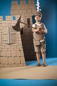 foto of berserk  - photo of the boy in medieval knight costume made of cardboard - JPG