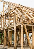 foto of rafters  - Wooden framing of the new residential house - JPG