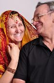 stock photo of indian sari  - Portrait of happy senior couple looking at each other - JPG