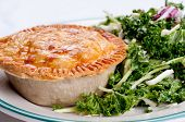 stock photo of crust  - kale salad and beef pot pie with flaky crust  - JPG