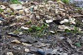 foto of polluted  - Rubbish pollution on the Saigon river bank in Vietnam - JPG