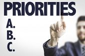 stock photo of priorities  - Business man pointing the text - JPG