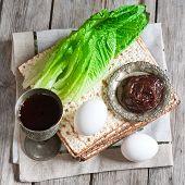 image of passover  - Wine egg bitter salad leaves matzot and haroset  - JPG