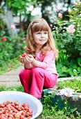 picture of strawberry blonde  - little girl with bowl strawberry on nature home backgraund - JPG