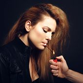 stock photo of exhale  - Woman with Cigarette Exhaling Smoke  on a Dark Background - JPG