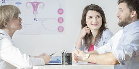 stock photo of insemination  - Young couple during visit at gynecological office  - JPG
