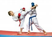 image of karate  - Children with red and blue belts are beating karate blows - JPG