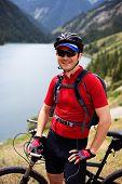 Cyclist Beside A Beautiful Mountain Lake