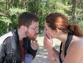 picture of she-male  - she lights a cigarette from the man - JPG
