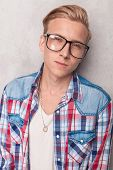 foto of casual wear  - Portrait of a casual young man wearing glasses - JPG