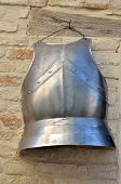 foto of breastplate  - old armor hanging on the wall of the building - JPG