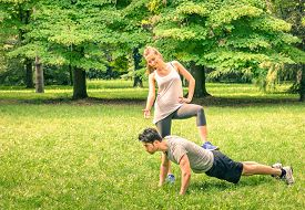 pic of male-domination  - Girlfriend mocking her boyfriend while training in the park  - JPG