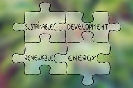 stock photo of land development  - elements of the green economy as pieces of puzzle - JPG