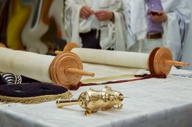 picture of torah  - Hebrew text of the Torah the wood parchment scroll and gold cap with a bells - JPG