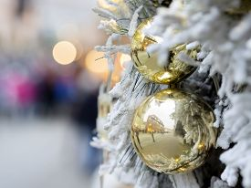stock photo of christmas  - Picture of decorations with branches snow and golden Christmas balls on a Christmas market - JPG