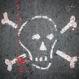 stock photo of skull cross bones  - Graphical representation of a human skull and traces of blood - JPG