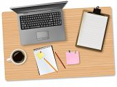 Grey notebook (laptop) and office supplies laying on the board. Vector.