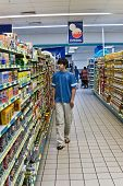 picture of grocery store  - Young man shopping in the supermarket people diversity series - JPG