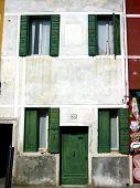 Venice House With Green Windows And Door On Burano Island, Italy