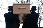 stock photo of mortuary  - Bearers are carrying a coffin to a cemetery - JPG
