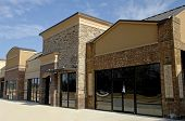 stock photo of commercial building  - Newly constructed commercial space available for sale or lease - JPG