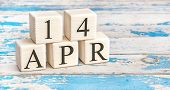 April 14Th. Wooden Cubes With Date Of 14 April  On Old Blue Wooden Background. poster