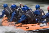Working Together In A Rafting Boat