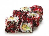 Night Philadelphia Maki Sushi - Roll made of Cream Cheese, Tamago (japanese omelet), Cucumber and Smoked Eel inside. Red and Black Tobiko (flying fish roe) outside